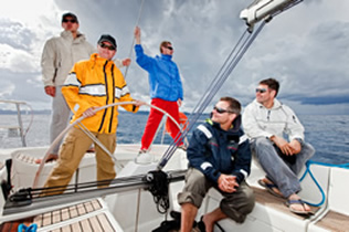 happy sailing crew on sailboat 1
