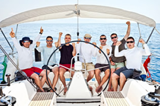 happy sailing crew on sailboat 2